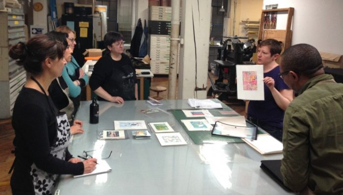 Instuctor Loree Ovens getting started at Open Studio's Monoprinting Workshop.