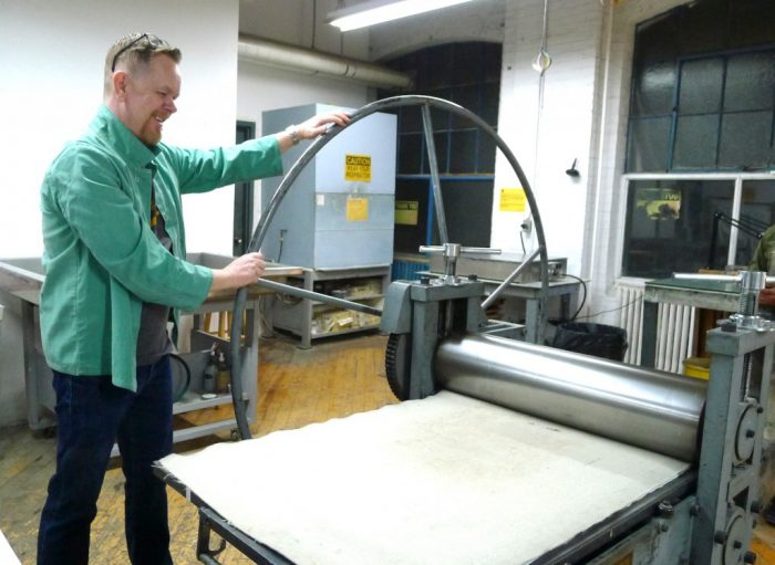 Trying out the printing press.